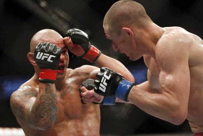 Thiago Alves, left, and Seth Baczynski fight in a mixed martial arts event on Saturday, April 19, 2014, at UFC Fight Night in Orlando, Fla. Alves won.