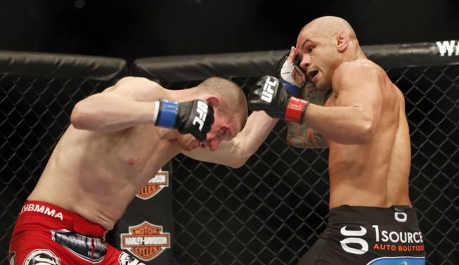 Thiago Alves, right, and Seth Baczynski fight in a mixed martial arts event on Saturday, April 19, 2014, at UFC Fight Night in Orlando, Fla. Alves won.