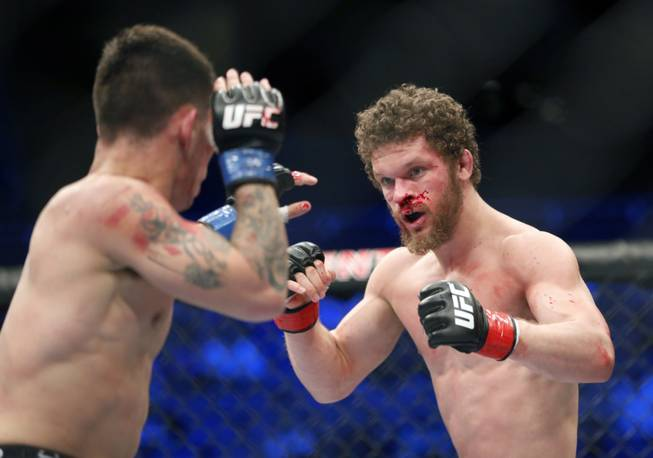 Dustin Ortiz, right, and Ray Borg fight in a mixed martial arts event on Saturday, April 19, 2014, at UFC Fight Night in Orlando, Fla. Ortiz won.