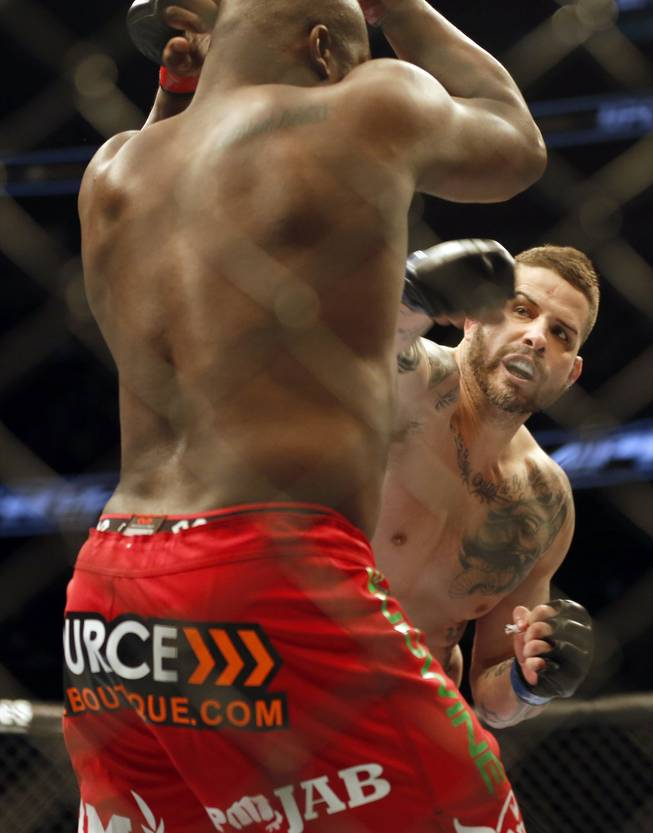 Derrick Lewis, left, and Jack May fight in a mixed martial arts event on Saturday, April 19, 2014, at UFC Fight Night in Orlando, Fla. Lewis won.