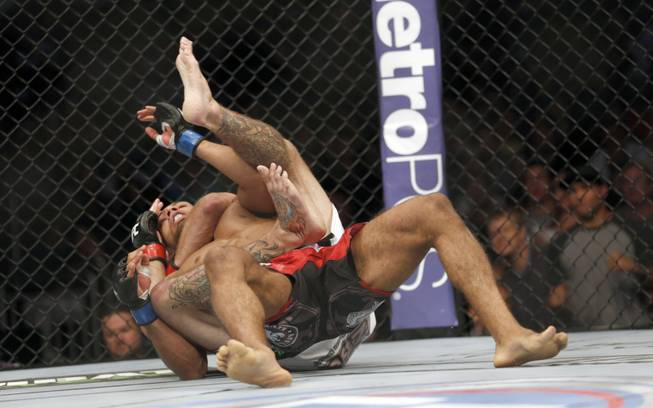 Donald Cerrone and Edson Barboza, of Brazil, top, fight in a mixed martial arts event on Saturday, April 19, 2014, at UFC Fight Night in Orlando, Fla. Cerrone won by tap out.