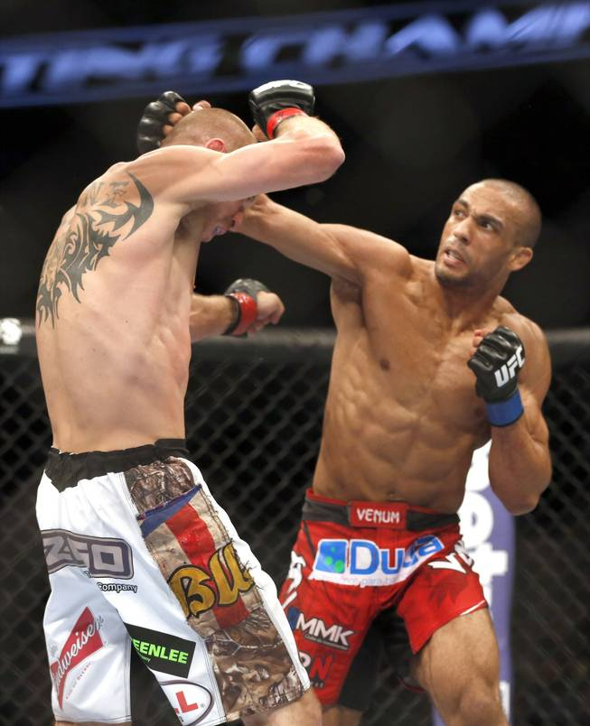 Donald Cerrone, left, and Edson Barboza, of Brazil, fight in a mixed martial arts event on Saturday, April 19, 2014, at UFC Fight Night in Orlando, Fla. Cerrone won by tap out.