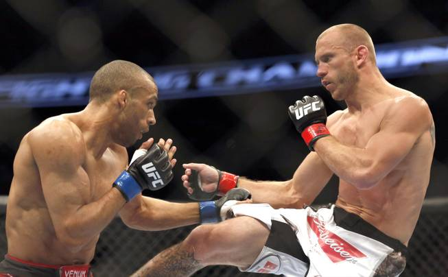 Donald Cerrone, right, and Edson Barboza, of Brazil, fight in a mixed martial arts event on Saturday, April 19, 2014, at UFC Fight Night in Orlando, Fla. Cerrone won by tap out.