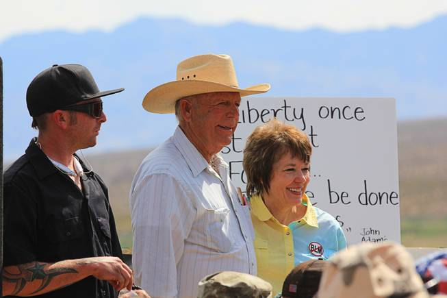 Rancher Cliven Bundy, center, and his wife Carol are shown at a meeting with supporters before the April 12, 2014 stand-off between the Bureau of Land Management and supporters of rancher Cliven Bundy near Bunkerville, Nevada. The BLM eventually called off their roundup of Bundy cattle citing safety concerns. Courtesy of Shannon Bushman.