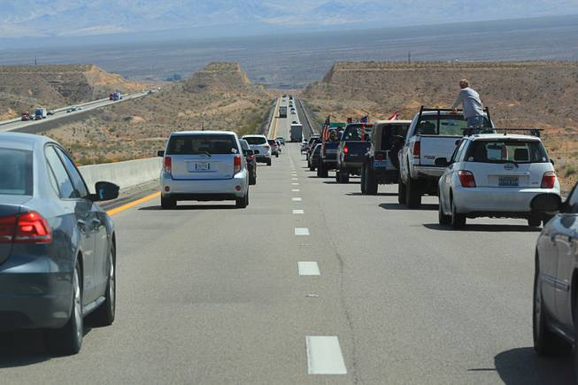 Supporters of Cliven Bundy drive on Interstate-15 to the April 12, 2014 stand-off between the Bureau of Land Management and supporters of rancher Cliven Bundy near Bunkerville, Nevada. The BLM eventually called off their roundup of Bundy cattle citing safety concerns. Courtesy of Shannon Bushman.