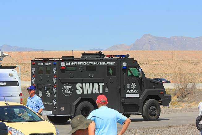 A Metro Police SWAT vehicle arrives at the April 12, 2014 stand-off between the Bureau of Land Management and supporters of rancher Cliven Bundy near Bunkerville, Nevada. The BLM eventually called off their roundup of Bundy cattle citing safety concerns. Courtesy of Shannon Bushman.