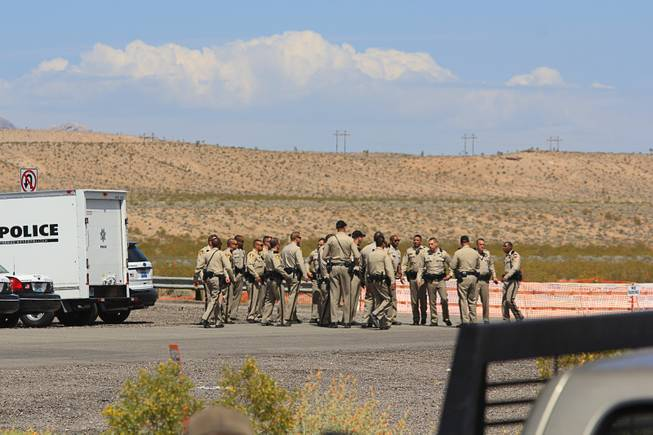 Metro Police officers confer at during the April 12, 2014 stand-off between the Bureau of Land Management and supporters of rancher Cliven Bundy near Bunkerville, Nevada. The BLM eventually called off their roundup of Bundy cattle citing safety concerns. Courtesy of Shannon Bushman.