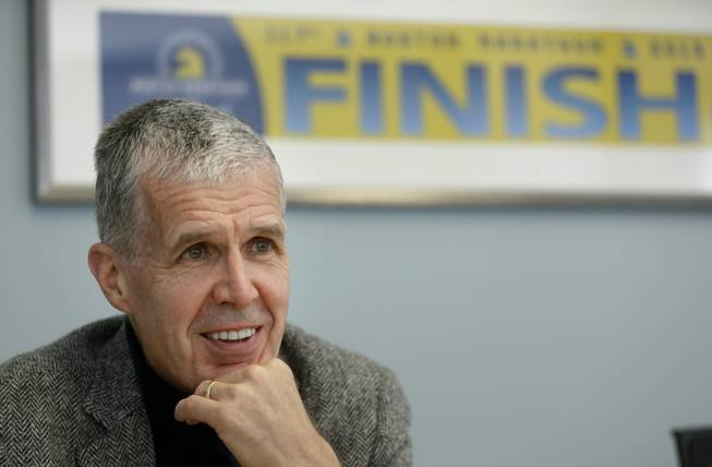 "In this photo taken April 10, 2014, photo Boston Athletic Association Executive Director Tom Grilk speaks with an Associated Press reporter in his office in Boston. More than 5,000 runners were still on the Boston Marathon course when the bombs went off near the finish line in 2013, so the field was expanded for the 2014 marathon to accommodate them. ""The thought was: If those people, like so many others, wanted to have some physical expression of resilience and determination, it would probably be that many of them at least would want to run the whole race,"" Grilk said."