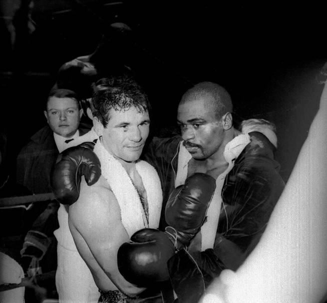 "In this Feb. 23, 1965, file photo, Rubin ""Hurricane"" Carter and Italian boxer Fabio Bettini pose after a fight at the Palais des Sports in Paris. Carter, who spent almost 20 years in jail after twice being convicted of a triple murder he denied committing, died at his home in Toronto, Sunday, April 20, 2014, according to long-time friend and co-accused John Artis. He was 76."