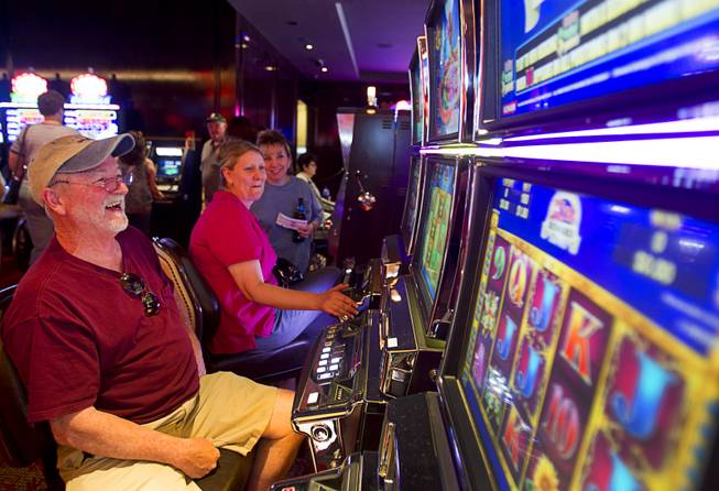 Dickie Sanders, left, of Elizabeth City, N.C. smiles as he wins $48.00 on a slot machine during the opening of the casino floor at the Cromwell, formerly Bill's Gamblin' Hall & Saloon, on the Las Vegas Strip and Flamingo Avenue, Monday, April 21, 2014. The casino will host a grand opening on May 21. The casino is undergoing a $185 million renovation project that includes remodeling of guest rooms, casino floor and common areas, the addition of a new second floor restaurant, and construction of the 65,000 square foot rooftop pool and dayclub/nightclub.