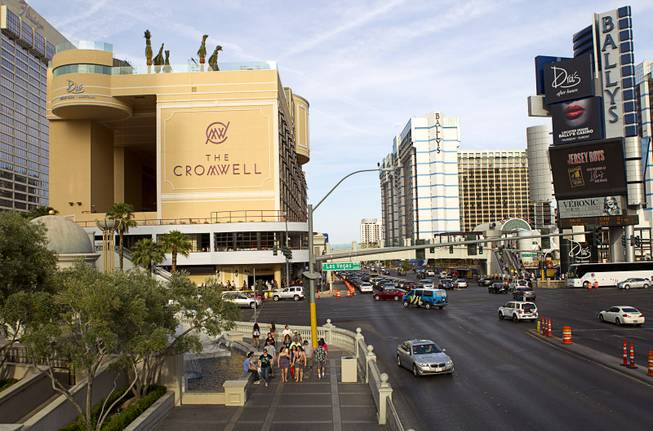 The Cromwell, left, formerly Bill's Gamblin' Hall & Saloon, is shown on the corner of Las Vegas Boulevard South and Flamingo Avenue, Monday, April 21, 2014. The casino is undergoing a $185 million renovation project that includes remodeling of guest rooms, casino floor and common areas, the addition of a new second floor restaurant, and construction of the 65,000 square foot rooftop pool and dayclub/nightclub.