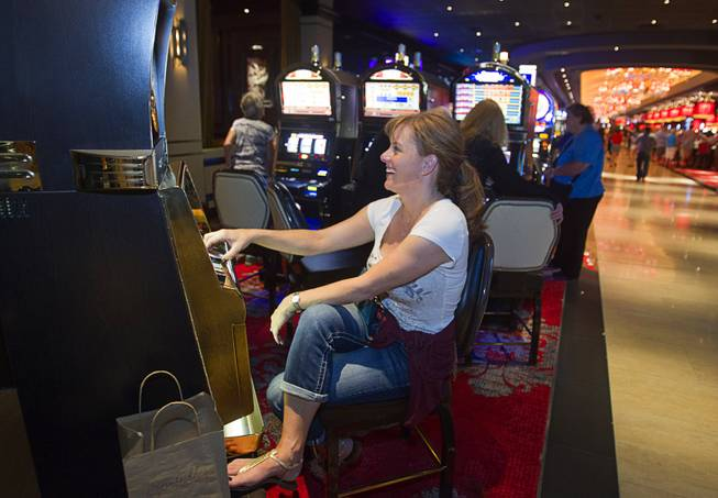 Alia Gettler of San Ramon, Calif. plays slots during the opening of the casino floor at the Cromwell, formerly Bill's Gamblin' Hall & Saloon, on the Las Vegas Strip and Flamingo Avenue, Monday, April 21, 2014. The casino is undergoing a $185 million renovation project that includes remodeling of guest rooms, casino floor and common areas, the addition of a new second floor restaurant, and construction of the 65,000 square foot rooftop pool and dayclub/nightclub.