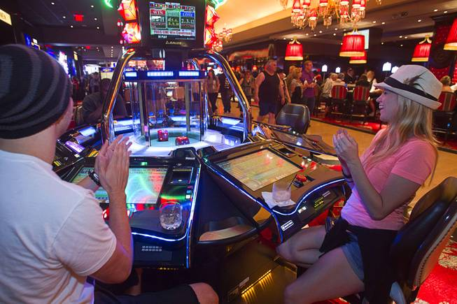 A couple plays an electronic craps machine during the opening of the casino floor at the Cromwell, formerly Bill's Gamblin' Hall & Saloon, on the Las Vegas Strip and Flamingo Avenue, Monday, April 21, 2014.