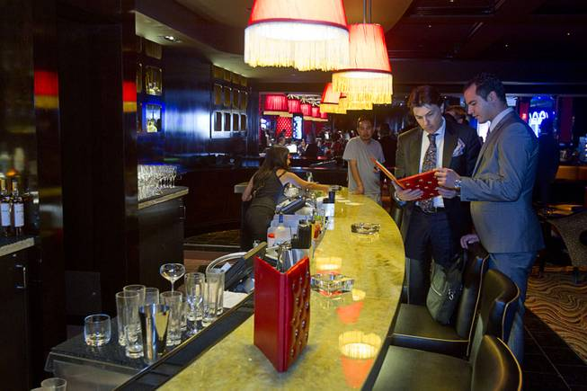 Mixologists Francesco Lafranconi, left, and Matteo Belkeziz look over a menu in the Interlude lounge during the opening of the casino floor at the Cromwell, formerly Bill's Gamblin' Hall & Saloon, on the Las Vegas Strip and Flamingo Avenue, Monday, April 21, 2014. The casino is undergoing a $185 million renovation project that includes remodeling of guest rooms, casino floor and common areas, the addition of a new second floor restaurant, and construction of the 65,000 square foot rooftop pool and dayclub/nightclub.