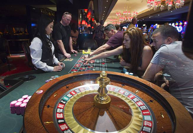 People place their bets on roulette during the opening of the casino floor at the Cromwell, formerly Bill's Gamblin' Hall & Saloon, on the Las Vegas Strip and Flamingo Avenue, Monday, April 21, 2014. The casino is undergoing a $185 million renovation project that includes remodeling of guest rooms, casino floor and common areas, the addition of a new second floor restaurant, and construction of the 65,000 square foot rooftop pool and dayclub/nightclub.
