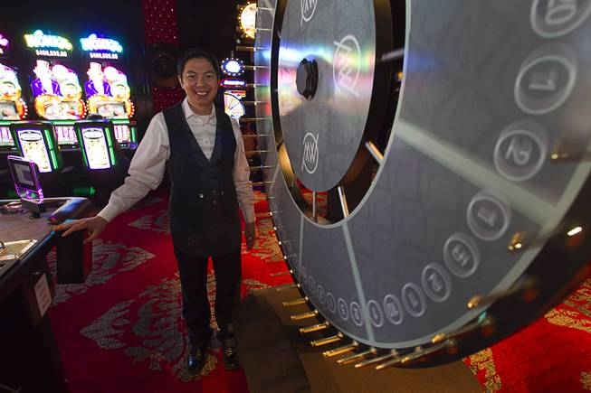 Lap Nguyen stands by the Big-Six wheel during the opening of the casino floor at the Cromwell, formerly Bill's Gamblin' Hall & Saloon, on the Las Vegas Strip and Flamingo Avenue, Monday, April 21, 2014. The casino is undergoing a $185 million renovation project that includes remodeling of guest rooms, casino floor and common areas, the addition of a new second floor restaurant, and construction of the 65,000 square foot rooftop pool and dayclub/nightclub.