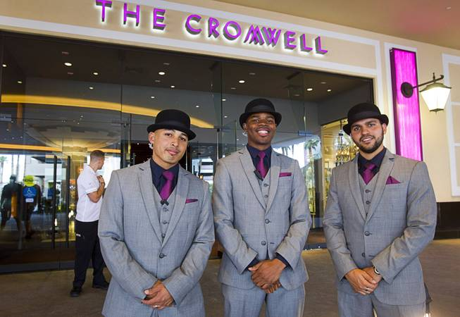 Doormen Jojo Corpus, left, Gary Harris, center, and Santiago Ortega pose in the Cromwell porte cochere during the opening of the casino floor at the Cromwell, formerly Bill's Gamblin' Hall & Saloon, Monday, April 21, 2014. The casino is undergoing a $185 million renovation project that includes remodeling of guest rooms, casino floor and common areas, the addition of a new second floor restaurant, and construction of the 65,000 square foot rooftop pool and dayclub/nightclub.