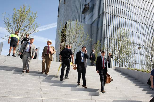 Federal Courthouse employees evacuate as police investigate a shooting inside the Federal Courthouse, Monday, April 21, 2014, in Salt Lake City. The shooting has left at least one person injured, a spokeswoman for the U.S. attorney said.