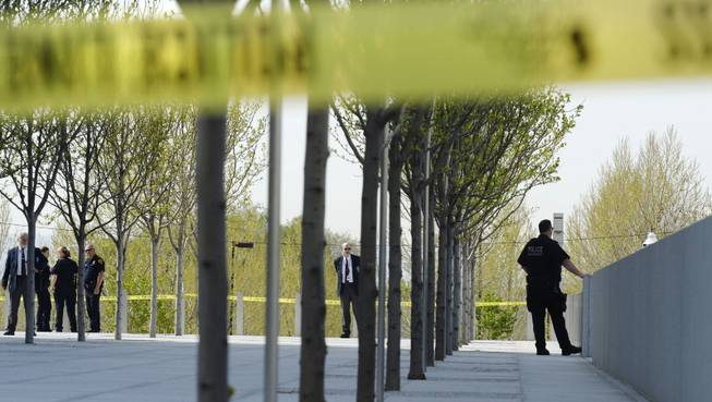 Authorities secure the plaza as police investigate a shooting inside the Federal Courthouse, Monday, April 21, 2014, in Salt Lake City. A U.S. marshal shot and critically wounded a defendant on Monday in a new federal courthouse after the man rushed the witness stand with a pen at his trial in Salt Lake City, authorities said.