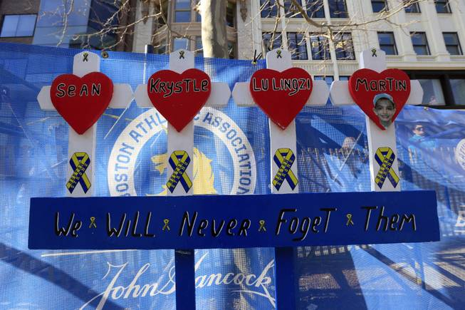 Shown is a makeshift memorial for the Boston Marathon bombing victims near the finish line ahead of Monday's 118th Boston Marathon, Saturday, April 19, 2014, in Boston.