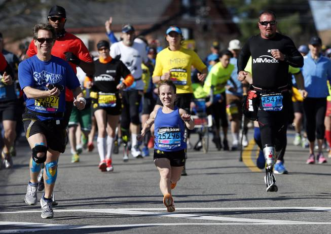 Mobility-impared runners David Abel, left, Juli Windsor, and Scott Rigsby compete in the 118th Boston Marathon Monday, April 21, 2014, in Hopkinton, Mass.