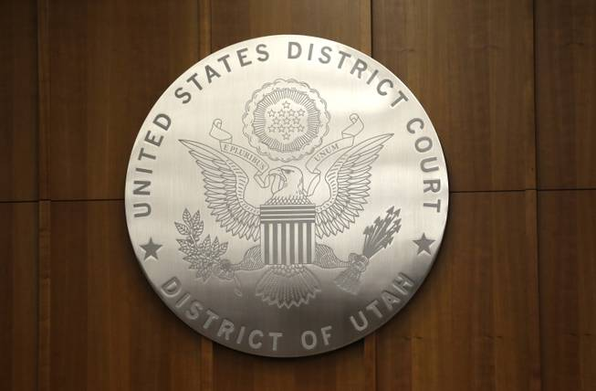 A United States District Court emblem is seen in a courtroom in the new Salt Lake City Federal Courthouse on Wednesday, April 9, 2014.