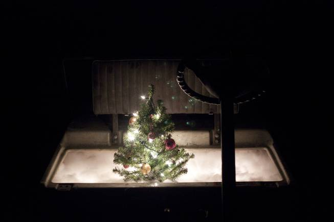 "A golf cart sculpture with a lit Christmas tree placed in the seat from artist Mark Brandvik's ""Volume Control"" exhibit at VAST Gallery."
