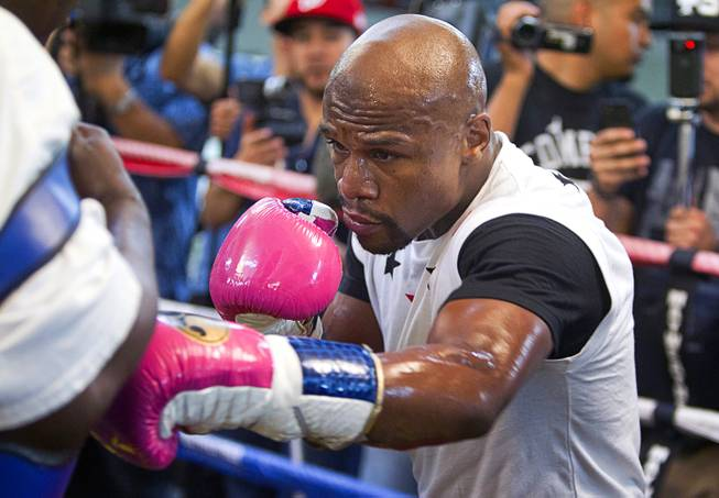 WBC welterweight champion Floyd Mayweather Jr. works out at the Mayweather Boxing Club Tuesday, April 22, 2014. Mayweather is preparing for his fight against WBA champion Marcos Maidana of Argentina at the MGM Grand Garden Arena on May 3.