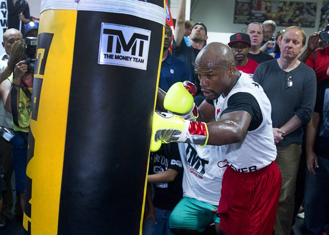WBC welterweight champion Floyd Mayweather Jr. hits a heavy bag during a media workout at the Mayweather Boxing Club Tuesday, April 22, 2014. Mayweather is preparing for his fight against WBA champion Marcos Maidana of Argentina at the MGM Grand Garden Arena on May 3.