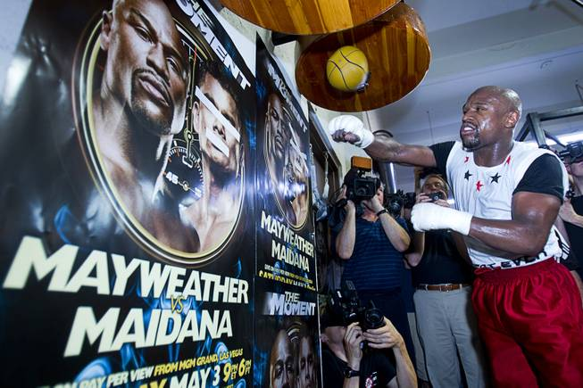 WBC welterweight champion Floyd Mayweather Jr. hits a speed bag during a media workout at the Mayweather Boxing Club Tuesday, April 22, 2014. Mayweather is preparing for his fight against WBA champion Marcos Maidana of Argentina at the MGM Grand Garden Arena on May 3.