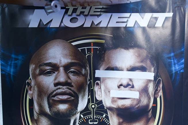 Tape is shown on a poster featuring the images of WBC welterweight champion Floyd Mayweather Jr. (L) and WBA champion Marcos Maidana in the Mayweather Boxing Club Tuesday, April 22, 2014. Mayweather is preparing for his fight against Maidana of Argentina at the MGM Grand Garden Arena on May 3.