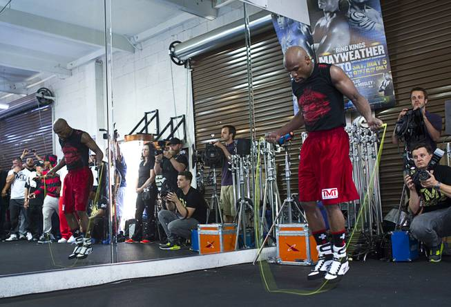 WBC welterweight champion Floyd Mayweather Jr. jumps rope during a media workout at the Mayweather Boxing Club Tuesday, April 22, 2014. Mayweather is preparing for his fight against WBA champion Marcos Maidana of Argentina at the MGM Grand Garden Arena on May 3.