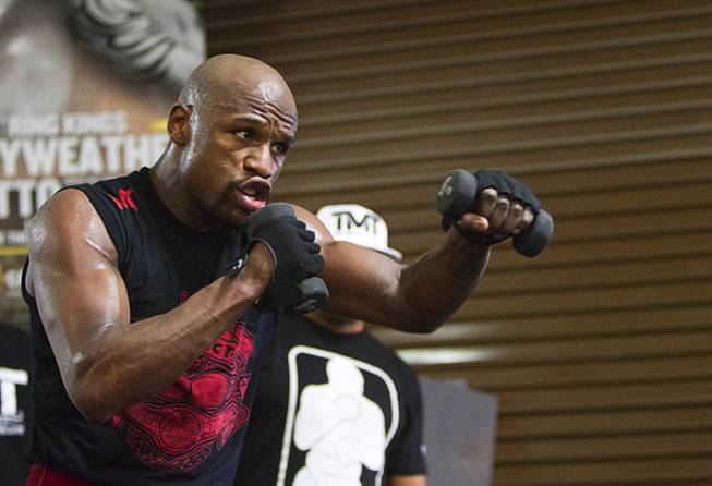 WBC welterweight champion Floyd Mayweather Jr. works out with weights at the Mayweather Boxing Club Tuesday, April 22, 2014. Mayweather is preparing for his fight against WBA champion Marcos Maidana of Argentina at the MGM Grand Garden Arena on May 3.