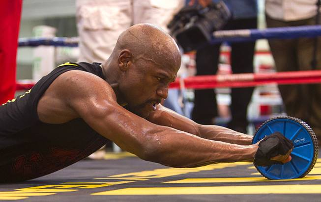 WBC welterweight champion Floyd Mayweather Jr. works on his abdominal muscles at the Mayweather Boxing Club Tuesday, April 22, 2014. Mayweather is preparing for his fight against WBA champion Marcos Maidana of Argentina at the MGM Grand Garden Arena on May 3.