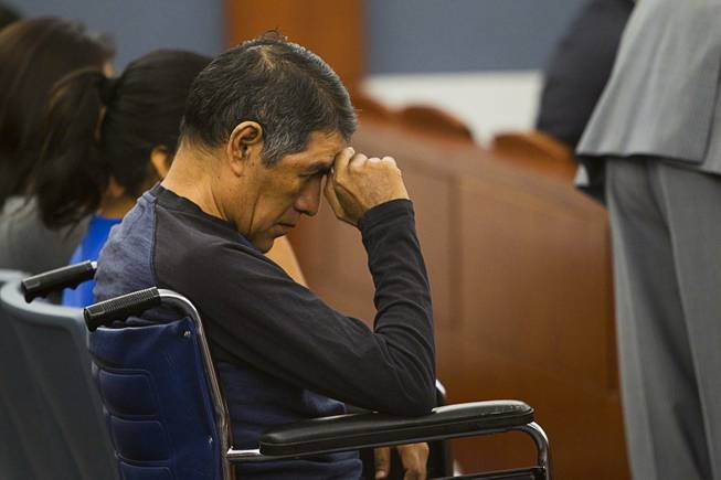 Lorenzo Alavez waits for the sentencing for Nyakueth Tear of Salt Lake City, Utah at the Regional Justice Center Tuesday, April 22, 2014. Tear struck eight pedestrians with her car in the street outside of a North Las Vegas church in August 2013 and fled the scene. Alavez was permanently disabled after the accident.