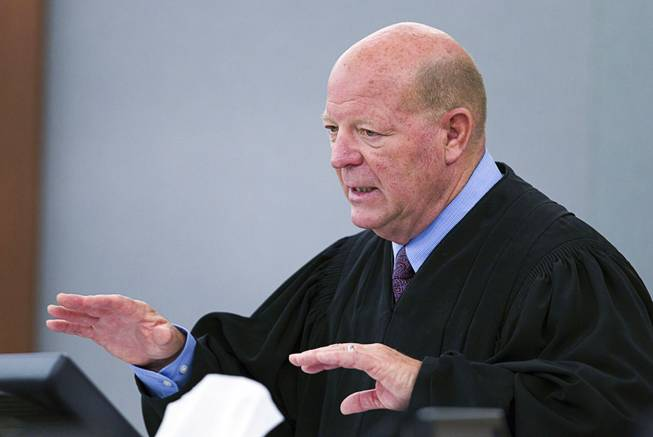Judge James Bixler speaks during sentencing for Nyakueth Tear of Salt Lake City, Utah at the Regional Justice Center Tuesday, April 22, 2014. Tear struck eight pedestrians with her car in the street outside of a North Las Vegas church in August 2013 and fled the scene.
