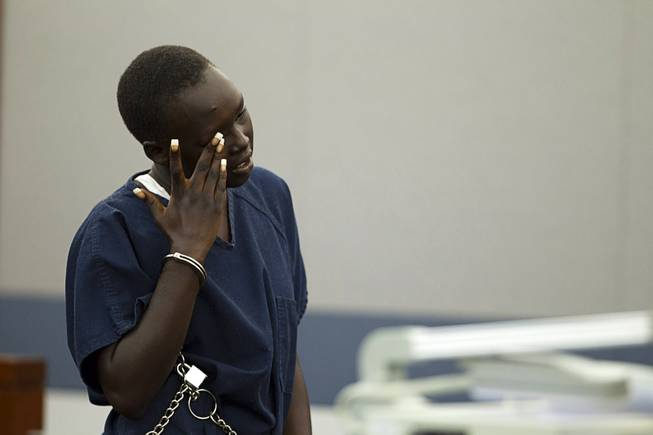 Nyakueth Tear of Salt Lake City, Utah wipes away tears during her sentencing at the Regional Justice Center Tuesday, April 22, 2014. Tear struck eight pedestrians with her car in the street outside of a North Las Vegas church in August 2013 and fled the scene.