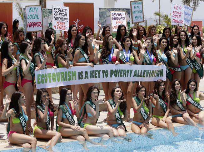 Candidates for the Miss Earth 2014 Philippines beauty pageant display Earth Day messages Monday, April 22, 2014 by the poolside of a hotel-casino at suburban Pasay city, south of Manila, Philippines. Some 49 candidates are vying for the title of the only beauty pageant with a unique theme of saving Mother Earth.