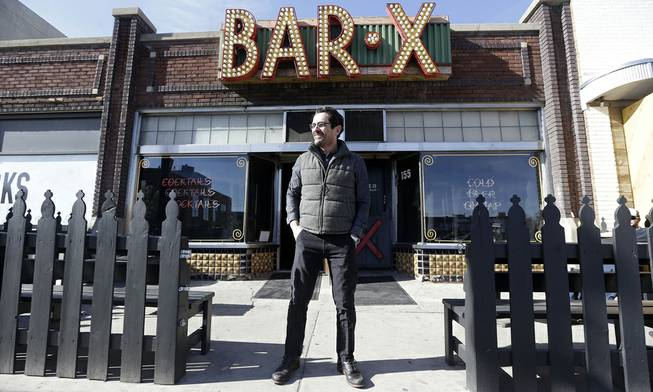 "Actor Ty Burrell, who plays bumbling dad Phil Dunphy on ABC's ""Modern Family,"" stands outside Bar X, the cocktail bar he co-owns in Salt Lake City on Wednesday, April 16, 2014."
