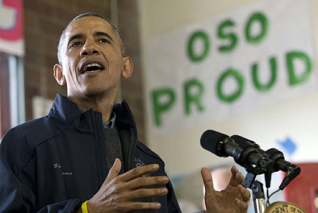 President Barack Obama speaks to first responders, recovery workers and community members at the Oso Fire Department in Oso, Wash., Tuesday, April 22, 2014, the site of the deadly mudslide that struck the community in March.