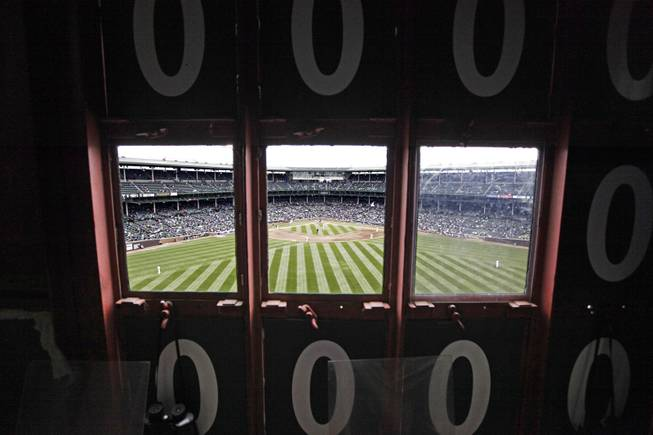 This April 10, 2014, photo shows a view of the field from inside Wrigley Field's iconic scoreboard during a baseball game between the Pittsburgh Pirates and the Chicago Cubs, in Chicago.