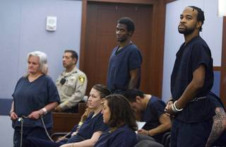 Theresa Allen, left, Emilio Arenas and Peyton Hemingway stand during a hearing at the Regional Justice Center Wednesday, April 23, 2014. The suspects are accused of torturing a homeless man before stuffing him into a suitcase and drowning him in a bathtub as they played the song