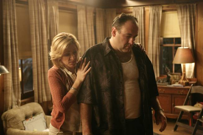 "In this file photo, originally released by HBO in 2007, Edie Falco portrays Carmela Soprano and James Gandolfini is Tony Soprano in a scene from one of the last episodes of the hit HBO dramatic series ""The Sopranos."" Amazon is teaming up with HBO, the first such streaming arrangement agreed to by the cable network, in a deal that will make available to Amazon Prime members some classic TV like ""The Sopranos"" and ""The Wire."""