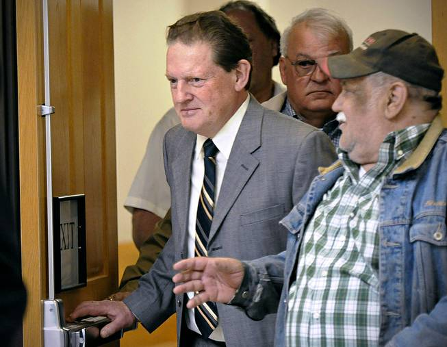 Byron Smith, center, comes out of a Morrison County courtroom in Little Falls, Minn., Monday, April 21, 2014, during a break in his trial.