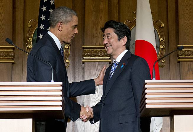 President Barack Obama, left, and Japanese Prime Minister Shinzo Abe shake hands at the conclusion of their joint news conference at the Akasaka State Guest House in Tokyo, Thursday, April 24, 2014.