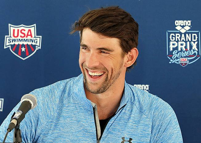 Michael Phelps speaks to the media after practice, Wednesday, April 23, 2014, in Mesa, Ariz. Phelps is competing in the Arena Grand Prix at Mesa on Thursday as he returns to competitive swimming after a nearly two-year retirement.