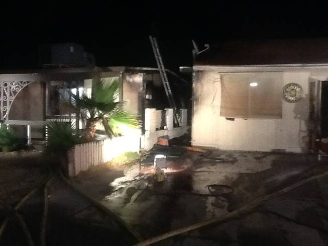 Las Vegas Fire & Rescue crews extinguished a fire that started between these two homes at 416 and 420 Princeton St. early Wednesday, April 23, 2014. Combined damage was estimated at $50,000.