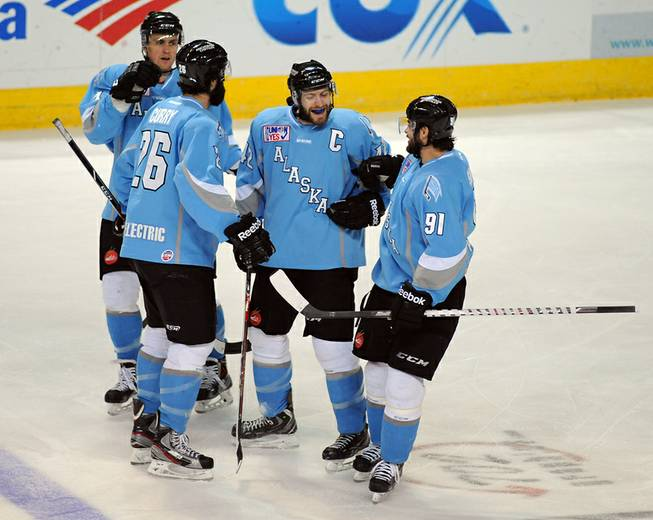 Alaska Aces center Nick Mazzolini (42) celebrates with teammates after scoring a shorthanded goal against the Las Vegas Wranglers on Wednesday night at the Orleans Arena.