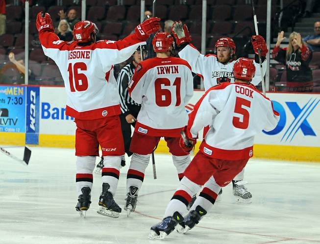Las Vegas Wrangler players come together to celebrate a second period goal scored by forward Shawn Skelly (right) on Wednesday night, his third goal in as many games against the Alaska Aces in this first round playoff matchup.