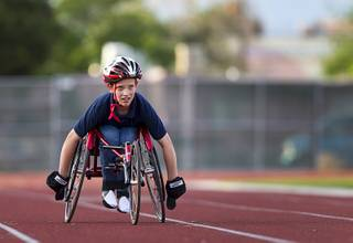 Blake Dickinson, 11, a sixth grader at Cadwallader Middle School student, practices with his trike on the track during a Paralympic Sports Night at Rancho High School Wednesday, April 23, 2014.